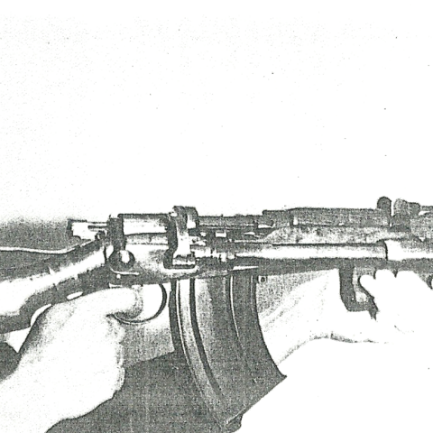 Henry Rieder demonstrating his automatic rifle.