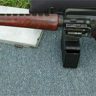 M16 rifle with Ceiner belt feed device. This model features wooden furniture.