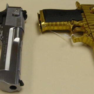 Chrome Desert Eagle and gold tiger-striped Desert Eagle