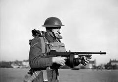 A british soldier with tommy gun