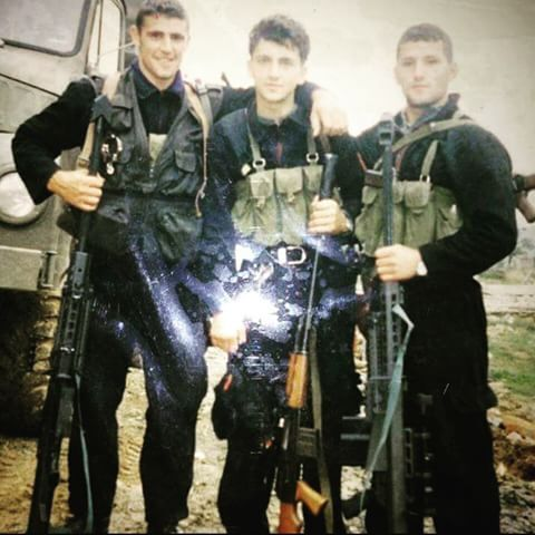 Three young Kosovo Liberation Army members holding two Barrett M82s during the 1999 Kosovo War.
