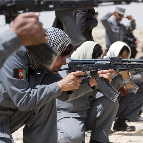 Afghan National Police women aiming their AMD-65s.