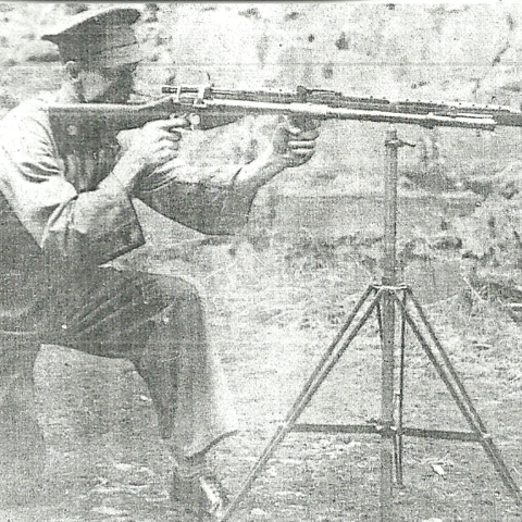 The Rieder rifle mounted on a tripod.