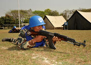Nepalese army Cpl. Bishnu Prasad Dhakal assumes a defensive position in a security training scenario at a simulated U.N. Headquarters compound March 11, 2012, during Shanti Doot 3 in Gazipur, Bangladesh 120311-A-KC839-087