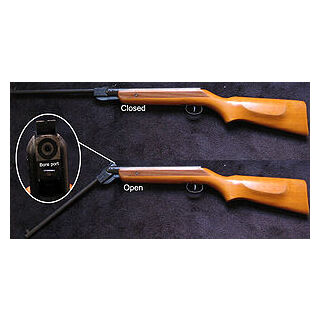 A air rifle with barrel open for loading.