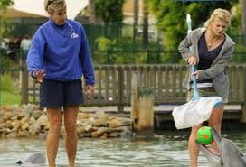 File:Cariba With Dolphin.jpg