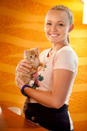 Carly with a kitten