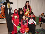 A wtich, a ninja, a cat, a hippie, Minnie Mouse and a vampire, circa 2003