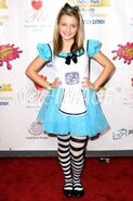 Laci Kay as Alice in Wonderland, at the 2012 Raise the Woof Halloween party