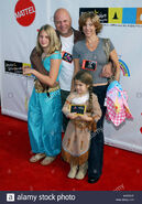 Michael-chiklis-with-wife-michelle-and-daughters-autumn-and-odessa-arriving-at-dream-halloween-2003-ribbon-of-dreams-at-the-barker-hangar-in-santa-monica-los-angeles-october-25-2003-chiklism-wife-daughter015