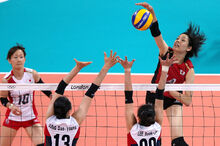 Olympics 2012 London-Women's Volleyball- Japan spikes the ball agianst Korea