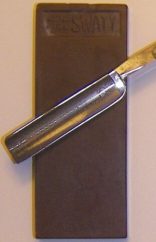 File:Honing stone and blade.JPG