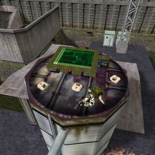 Cooper lying dead next to the Tactical Map, from above.