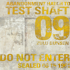 Test Shaft 09's name and condemnation date stencil as seen left of the Abandonment Hatch, on its original concrete texture.