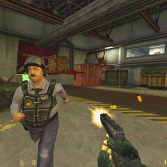 Helmet Otis running from Headcrabs. Of note is that in the retail version no security guard is present in that room and that the floor is covered of radioactive waste. The HUD was also changed from yellow to green.
