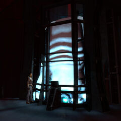 Alyx is watching as an Advisor is leaving in its pod in the Citadel.