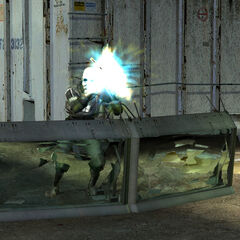Metrocop firing an Emplacement Gun at Freeman near the APC garage in the Canals.