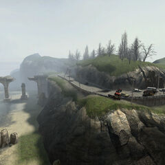 Bridge and wrecked vehicles.
