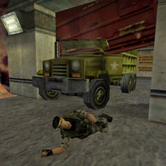 A dying HECU soldier warns Shephard about what awaits him in the underground parking near a M35 cargo truck crushed by a blast door.