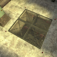 The entrance to the sewers. The four red lights on each side are blinking.