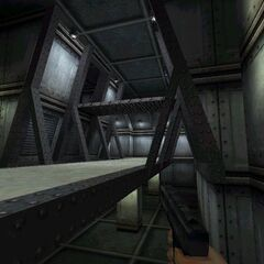 Player with an early viewmodel in an unknown area.