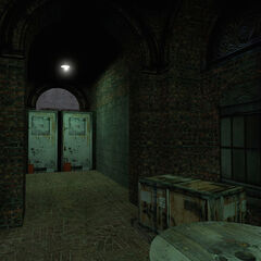 The hallway seen in the <i>Get Your Free TVs!</i> official screenshot (seen from the same spot). Note that the car has been replaced with an early <a rel=