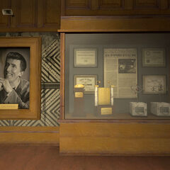 Cave Johnson's first portrait and award case in the Testing Lounge.