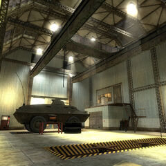 APC being repaired in the Combine Factories garage, in the map