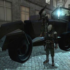 A parked APC with CPs on guard.