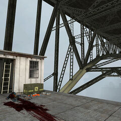 Cabin under the bridge, with a dead Citizen and ammo, notably rockets to be used against the Gunship.