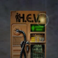 An HEV suit charger being highlighted by a sprite.