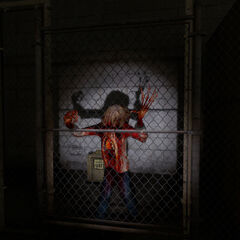 A Zombie trying to break a fence.
