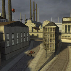The street near Kleiner's Lab in the playble <i>Half-Life 2</i> Beta, featuring the Scout Car as a placeholder for the APC, flying crows, and a Combot. On the background are seen more factories than in the final game. The crows have also been replaced by pigeons.