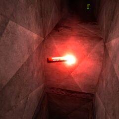 A lit emergency in a pitch black ventilation shaft in <i>Episode One</i>.