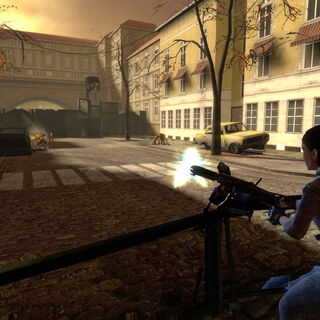 Alyx firing at Antlions with an Emplacement Gun on a City 17 street.