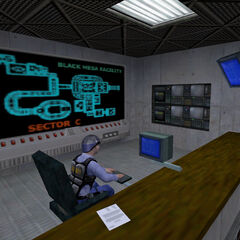 Security guard working on a computer in Sector C.