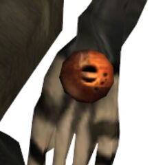 The Alien Assassin's left hand, with the orange sphere.