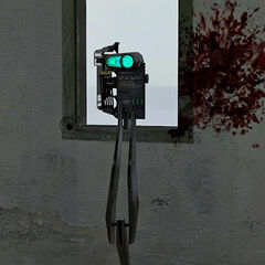 The Combine Binoculars attached to the wall, seen from inside, with Overwatch Soldier blood on the wall.
