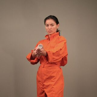 Reference shot of Alésia Glidewell as Chell taken in August 2006, with orange jumpsuit and ASHPD placeholder, sent by e-mail to a <a href=
