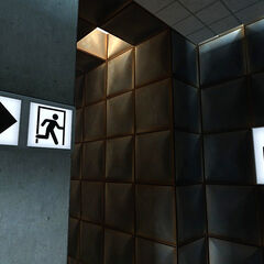 Signs indicating that after Test Chamber 19 comes the exit and cake.