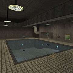 The pool in the Aquatic Center, with a dead security guard floating.