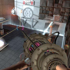 The early Aperture Science Handheld Portal Device and Weighted Storage Cube in an early Test Chamber 13.