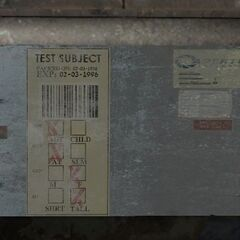 The panel on the back of a Relaxation Center room that labels the Test Subject. Apparently, this subject was an 'tall' and 'fat' adult female who was 'packed' February 3, 1976, and unless removed from stasis, would 'expire' exactly twenty years later.
