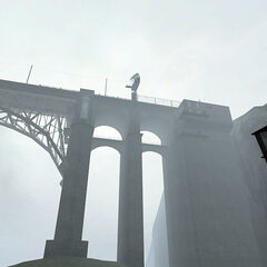 The end of the bridge in the fog.
