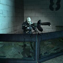 Metrocop manning an Emplacement Gun during Freeman's way back through the APC garage.