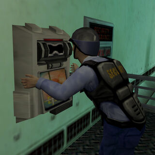 Security guard operating a Retinal Scanner for Cross and Green to proceed.