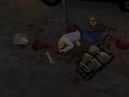 Armor and revolver near dead guard