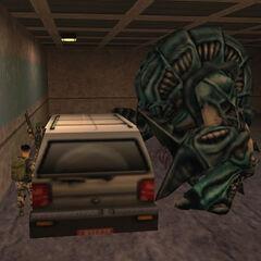 Gargantua empujando un SUV hacia unos soldados HECU