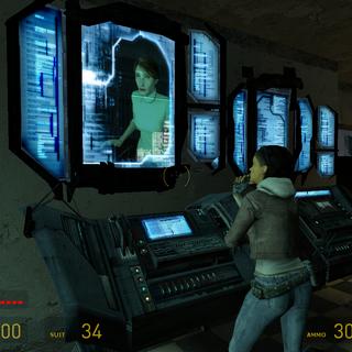 Mossman vista desde un monitor hablando con Breen