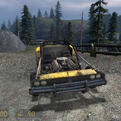 Muscle Car estacionado ante un bosque